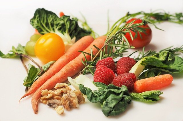 A plate of fresh fruit and vegetables